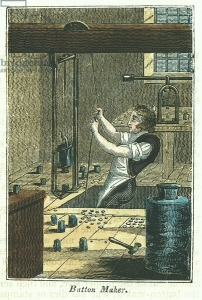 UIG538681 Button Maker: Stamping out metal buttons. Blank held in place and weight holding die for pattern being work was raised by rope and pulley wheel and dropped on blank. Dies for different sizes and patterns on floor. Buttons would need finishing by removal of burrs and imperfections. Hand-coloured woodcut from The Book of English Trades London 1823.; Universal History Archive/UIG; out of copyright